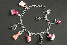 Fashion Bracelet. Pink Dress Bracelet. Enamel Charm Bracelet. Shopping Bracelet. Little Black Dress Jewelry. Silver Bracelet. Pink Bracelet. by GatheringCharms from Gathering Charms by Gilliauna. Find it now at http://ift.tt/2dTiIbp!