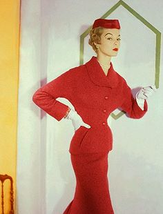 Jean Patchett is a vision of stylish loveliness in a ruby red suit dress,1953. #vintage #fashion #1950s