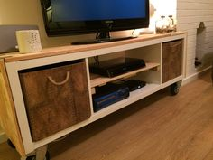 DIY IKEA Kallax cabinet hack, to go an create the most awesome TV cabinet while using the very famous square IKEA cabinet