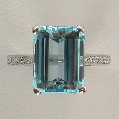 Emerald Cut Aquamarine with Thin Diamond pave Band ring
