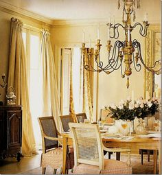 Monotone neutral/gold dining room by cote de texas