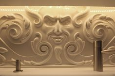 Carved Terracotta upstand, Corian vanity units.