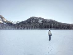 Walking on the frozen lake at Joffre Lakes Provincial Park - Canada
