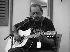 With a voice full of life, former sharecropper Boo Hanks—who reportedly shares a lineage with both Abraham Lincoln and Blind Boy Fuller—is an authentic master of the fingerpicked Piedmont style. For good reason, too: He's played it since growing up in the hills of rural Vance County, NC...