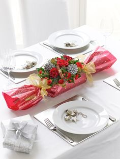 We've designed this stunning festive centrepiece to give a fun yet stylish focal point to the Christmas table. A hand-picked selection of rich red roses and carnations are expertly arranged with seasonal foliage into a long, elegant Christmas cracker shape that will co-ordinate perfectly with the other table arrangements. #MyPerfectInterfloraChristmas
