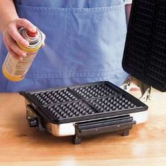 Preheat the waffle iron, and then coat the iron with cooking spray. - Photo…