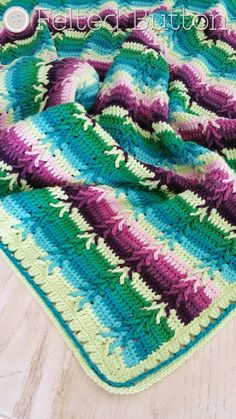 Felted Button - Colorful Crochet Patterns: This Way to Rows of Posies: Two New Blankets! ༺✿ƬⱤღ https://www.pinterest.com/teretegui/✿༻