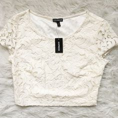 PM Editor Share Lace Short Sleeve Crop Top Lace crop top. Color: cream. Zips down the side. Express Tops Crop Tops