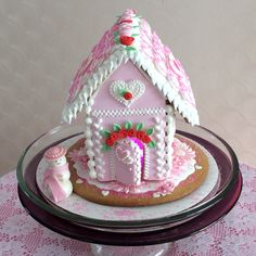 Valentine gingerbread house. All royal icing decorations. Sugar paste snow lady.