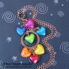 Learn how to make your glitter heart beads from polymer clay with this tutorial. Add a splash of color and sparkle to your look with this DIY necklace project.