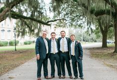 Groomsmen's suits at Wedding Angels Bridal Boutique  navy groom suit | navy groomsmen suits | atlanta wedding boutique