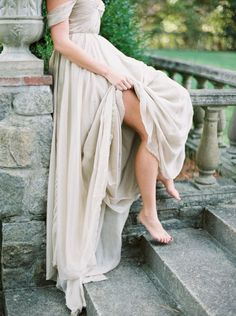 Grecian inspired taupe wedding dress made of silk, off the shoulder, bare foot