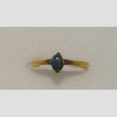Ring  Italy  13th/14th century  Gold stirrup ring, the high, flat bezel with two projecting claws set with a rough cabochon sapphire