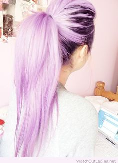 Awesome lilac pastel hair color with dark roots