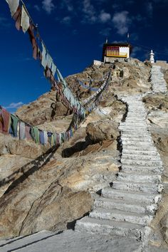 """There are prayer flags, lonely, ragged but enduring, high on pinnacles of rock above me; they flap in the wind, breathing everywhere the words of the Buddha."" A.Harvey #NomadsSecrets"