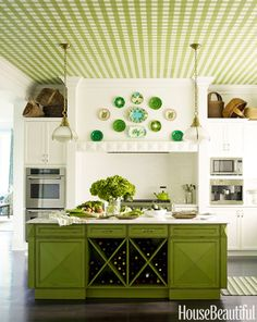 "In a Purchase, New York, kitchen, designer Gideon Mendelson created a green gingham ceiling that was first painted on canvas by Silvère Boureau. Mendelson says, ""It gives a classic white kitchen personality, and it brings extremely high ceilings down to a more comfortable place."" To further animate the room, Mendelson designed the island and painted it a custom bright green. - HouseBeautiful.com"