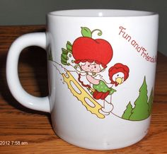 http://www.ebay.com/itm/1983-American-Greetings-Strawberry-Shortcake-Cherry-Cuddler-Butter-Cookie-Mug-/141389972042?pt=LH_DefaultDomain_2&hash=item20eb7fc24a