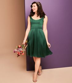 Radiate modern glamour in this emerald green, clean-lined, crepe-back satin scoop tank, knee-length bridesmaid dress with flattering bodice seams! | #shortbridesmaiddress #greenbridesmaiddress | Style F20244 in Juniper | Shop this style and more at davidsbridal.com Emerald Green Bridesmaid Dresses, Knee Length Bridesmaid Dresses, Green Clean, Davids Bridal, Green Wedding, Bodice, Satin, Glamour, Formal