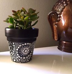 Black and white hand painted terra cotta pot. 4 in x 4 in. For indoor and outdoor use. perfect for succulents, air plants, and cacti.  Does not contain a drainage hole.      Shop: https://www.etsy.com/shop/SunAndHandCreations