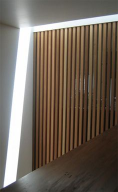 Cedar battens illuminated by skylight