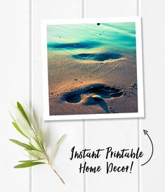 A digital download of a square fine art photograph of a footprint in the sand at sunset. It was taken on the beach of Lake Michigan in the summer.