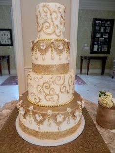 gold scroll wedding cake wwwcheesecakeetcbiz wedding cakes charlotte nc