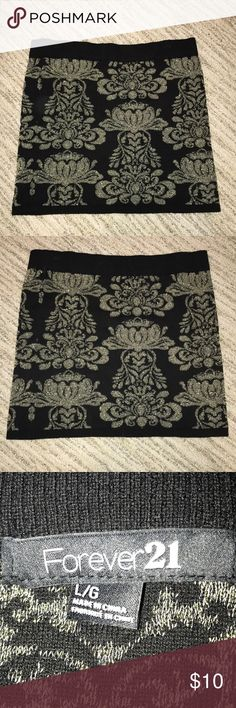 Black and gold stretchy Forever 21 skirt! Black and gold glittered designed skirt! Never worn, perfect condition!  Size Large Will take offers! Forever 21 Skirts Mini