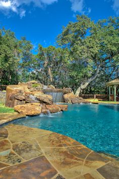 Large second pool step, beautiful real rock waterfall with multiple spillways.