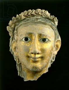 Mask From the Mummy of a Woman, Roman Period, 1st century AD (plaster). National Museums of Scotland / The Bridgeman Art Library