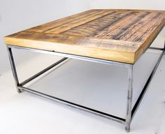 Minimalist reclaimed wood coffee table with an industrial metal frame / Ripley coffee table with rustic finish. $435.00, via Etsy.