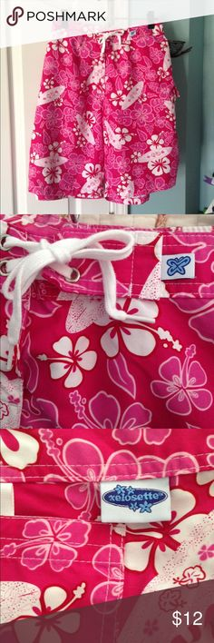 Women's Board Shorts Xelosette brand women's board shorts in a bright pink floral pattern. Shorts have side pocket and Velcro/tie closure. In excellent condition and from a smoke free home. Xelosette Shorts Bermudas