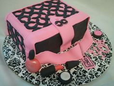 Coach purse and make up birthday cake made by Lakeisha Hill / Keck with Sweet Tooth Mother and Daughter Cakes.
