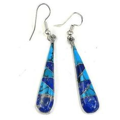 Turquoise and Lapis Tear Drop Earrings Handmade and Fair Trade. Handmade earrings from Mexico of turquoise and lapis artistically arranged in the shape of a long tear drop, embedded in a setting of alpaca silver. Earrings dangle 1.5 inches from hypoallergenic hooks.