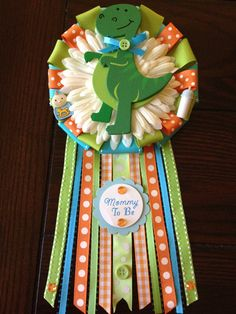 Cute and colorful T-Rex Mommy to Be corsage.