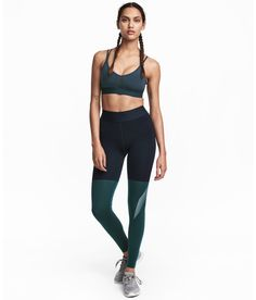 Check this out! Color-block sports tights in fast-drying, functional fabric with an elasticized waistband and reflective details. - Visit hm.com to see more.