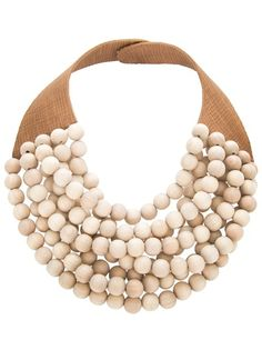 Brown calf leather necklace from Rosanna Fani featuring a multi-strap wood effect beads design to the front, a thick textured leather neck strap, $167