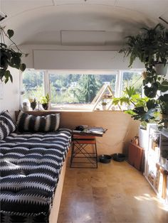 Tagged: Living Room, Bench, Shelves, and End Tables. Photo 6 of 18 in A Couple Transform a Vintage Airstream Into a Scandinavian-Inspired Tiny Home