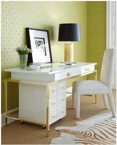Lime green and white office. The black lampshade adds the perfect amount of darkness to ground the space. Lilly Pulitzer Home