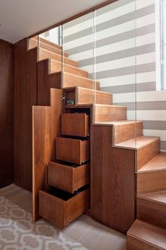 Contemporary Staircase with curved staircase, High ceiling, Oak stairs and shelving, Tan and white area rug, Hardwood floors