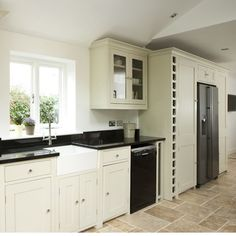 one wall kitchen with full rise units - maybe need to create light instead of window by adding mirrors?