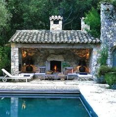 Mediterranean Swimming Pool with Wall sconce, Glo-Fire Cascade Vented Gas Log Set, Custom built-in seating, Outdoor pool