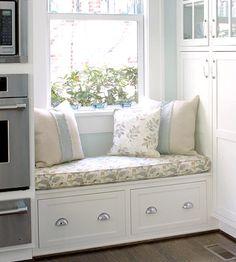 Kitchen window seat with storage below.