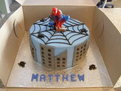... iced in buttercream with fondant decorations, Spiderman candle