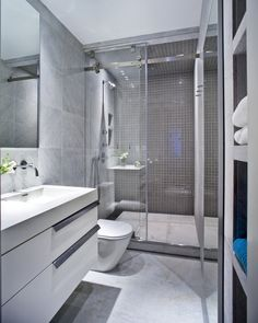 Luxurious UN Plaza Apartment Design by ORA Studio: luxurious neat bathroom interior decor on UN Plaza Apartment with marble tile white sink also shower system with glass divider