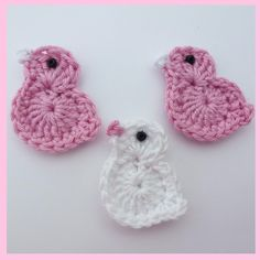 3 large pink and white crochet birds.