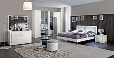Italy made contemporary bedroom set. Romance your home most private place with the Italian bedroom. Furnishings supremely elegant, yet oh, so easy. Distinguished by simple clean look, hand-finished in white and lacquered. Finished in beautiful high gloss white lacquer with leather accents these item...