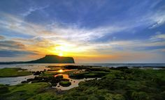 Udo Island - Udo, is located on the northeast of Seongsan-ri, 3.5 kilometres (2.2 miles) off the coast of Jeju, South Korea. This is the largest of the islands included in Jeju-si.