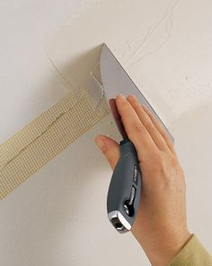 Repairing a crack in the wall: Cover the crack with self-adhesive Fiberglass mesh joint tape. Apply a thin layer of joint compound and lightly sand with fine grit sandpaper.