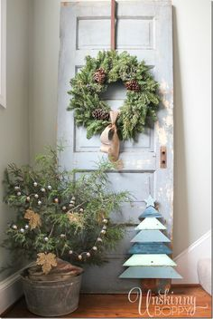 Gorgeous rustic Christmas decor. Tree in a galvanized bucket, chippy old door with a wreath, and a Christmas tree made from architectural salvaged | http://christmas-decor-styles.lemoncoin.org