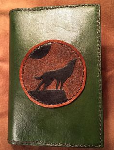 Green sketchbook/journal/diary cover with tooled black howling wolf silhouette on brown - refillable